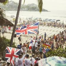 Flags flying at opening ceremony on Sayulita beach